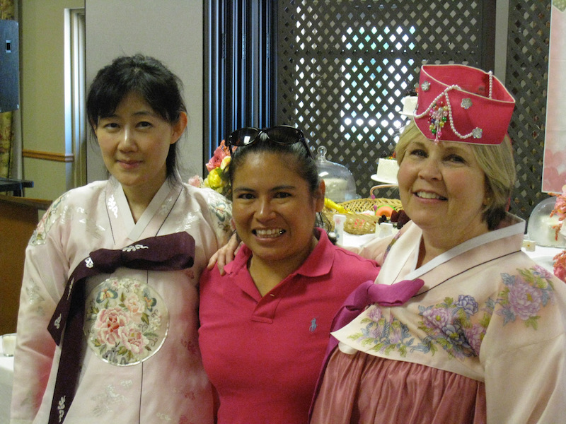 An American church member (right) with the wives of two international students / Courtesy of RUF-I