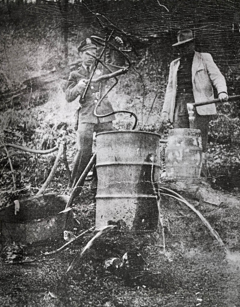 Two men destroying a still in Rockdale, Tennessee, ca. 1930s.  Tennessee State Library and Archives (http://share.tn.gov/tsla/exhibits/prohibition/index.htm).