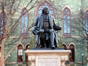 Statue of Benjamin Franklin in front of College Hall.  Matthew Marcucci, Wikimedia Commons, Public Domain.