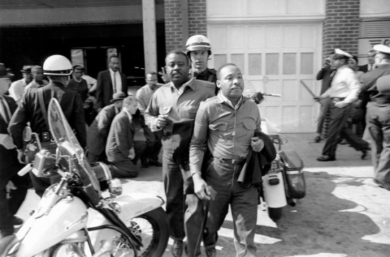 Rev.-Ralph-Abernathy-left-and-Rev.-Martin-Luther-King-Jr.-are-removed-by-a-policeman-as-they-led-a-line-of-demonstrators-into-the-business-section-of-Birmingham-Alabama-on-April-12-1963.-AP-Photo-650x430