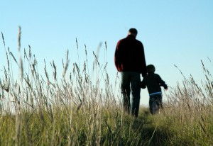 father-son-walking-field