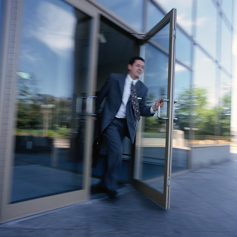 man-leaving-office-door
