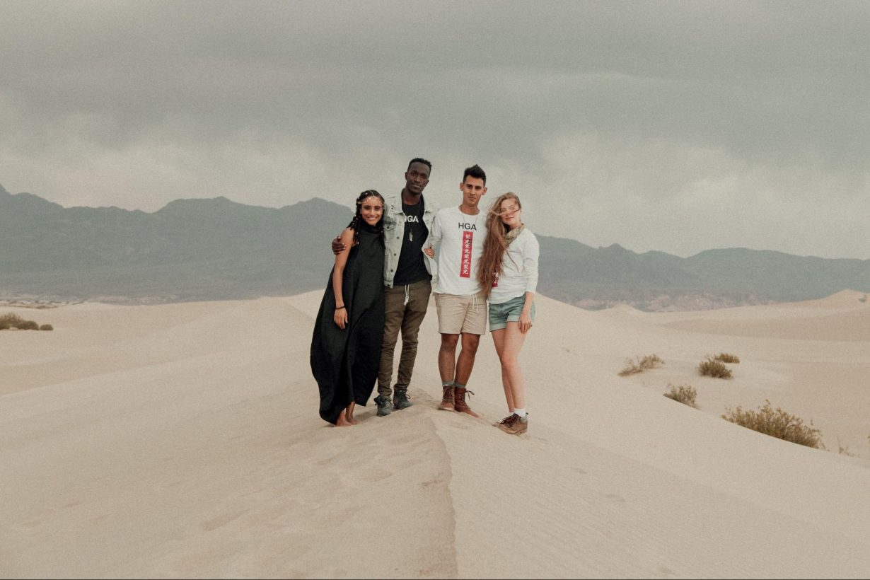 Jon Aragon, Quina Aragon, Juan Garcia, and Haylee Garcia standing in the desert.