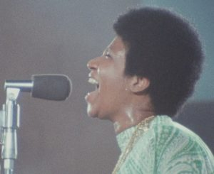 "Aretha Franklin sings in the 1972 performance captured in ""Amazing Grace."" 