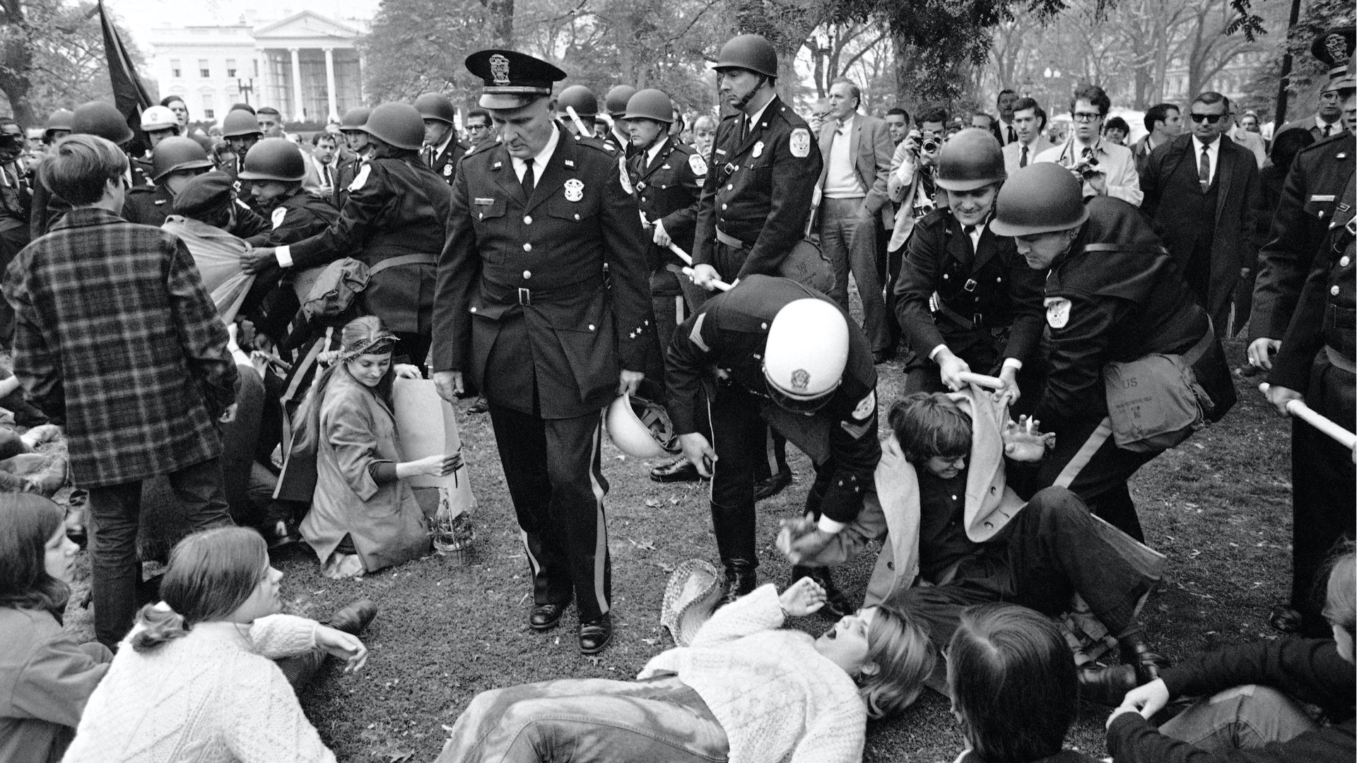 students and police clashing during protests in Lafayette Park in shadow of the white house in 1968