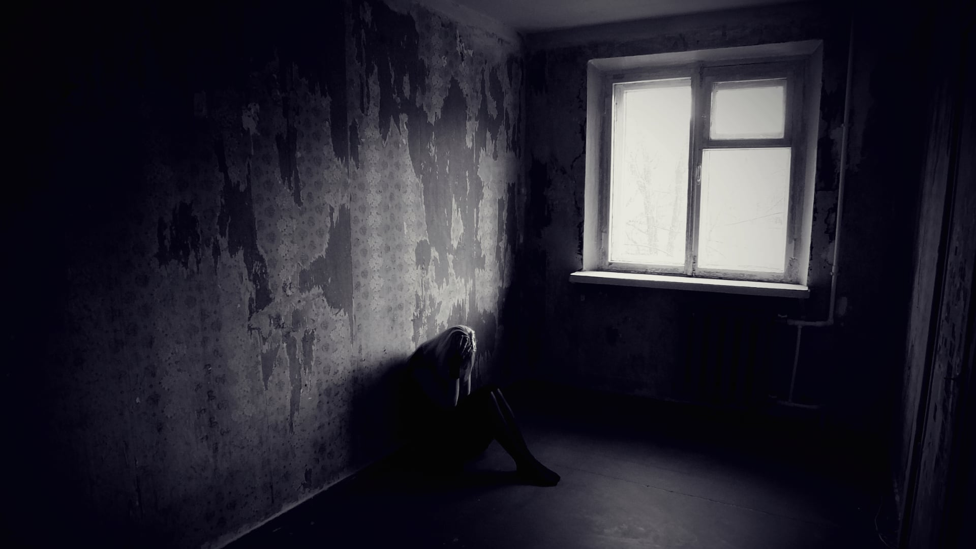 sad woman in dark room