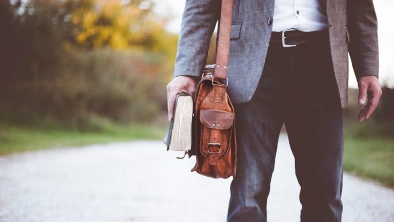 man carrying Bible