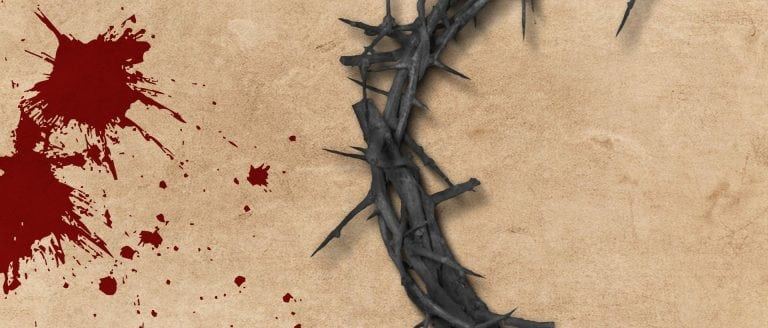Blood splatters on left hand side, crown of thorns on right - on a sand stone background