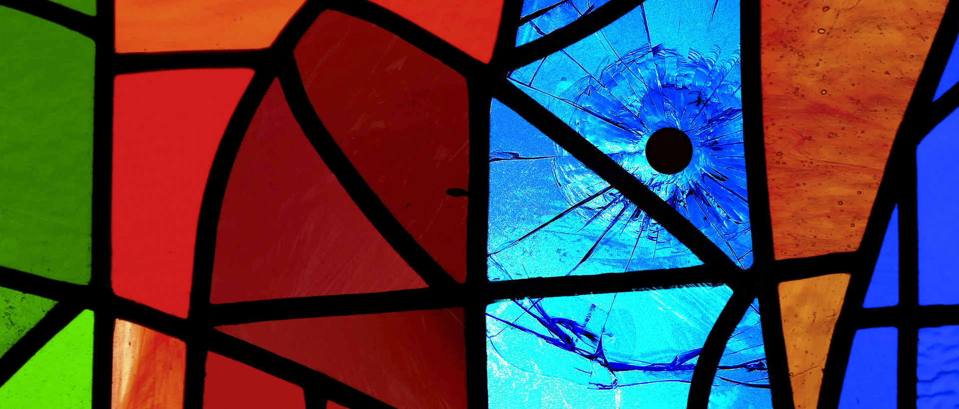 Evangelism Threatened imagery: Stained Glass panel with bullet hole