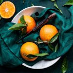 Citrus Fruit in bowl with a knife