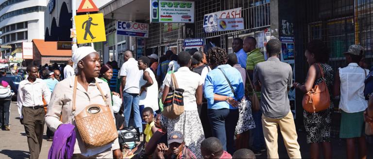 People queuing in Zimbabwe street