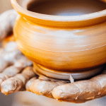 Leadership an antidote to chaos image - hands forming clay pot