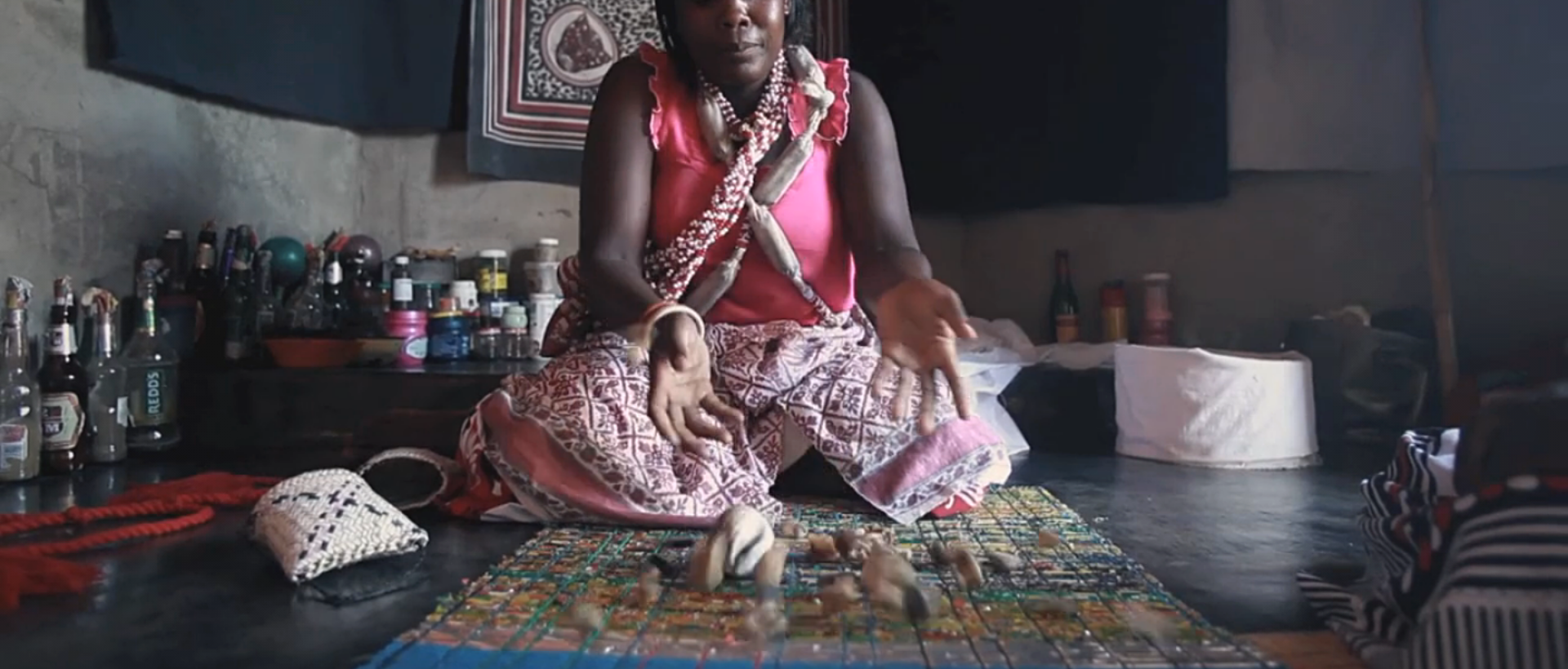 Ancestral Worship - A Sangoma consulting the bones