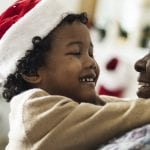 Be attentive to others at Christmas - man and child in Christmas hats