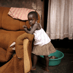 Called to Care? Ugandan child and broken chair