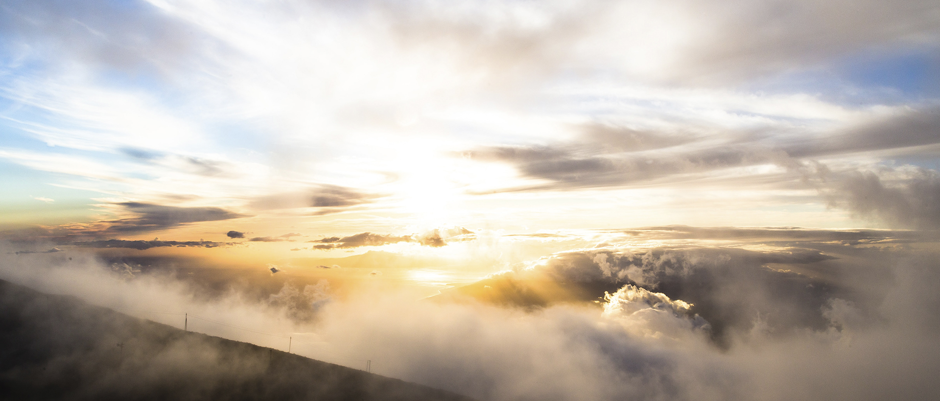 The Book of Revelation: Image of Christ's return - sunrise over clouds