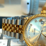 Can a Christian be Rich? Image of expensive items - mac keyboard and expensive watch