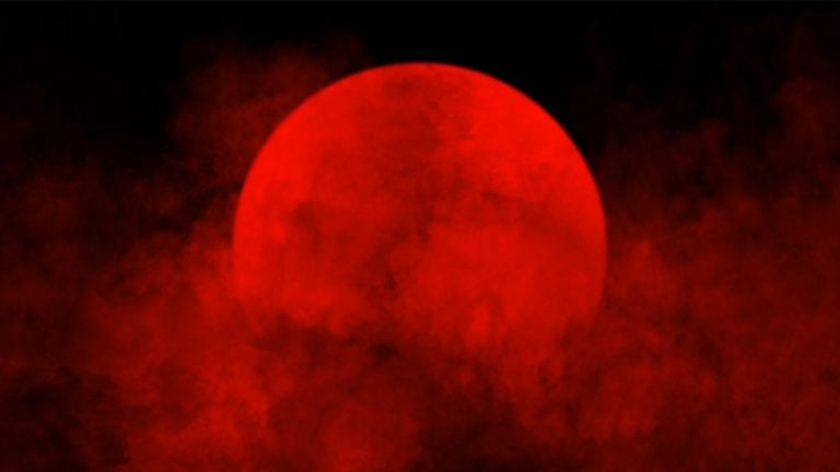 Is this the End of the World? Red Sun shrouded in smoke