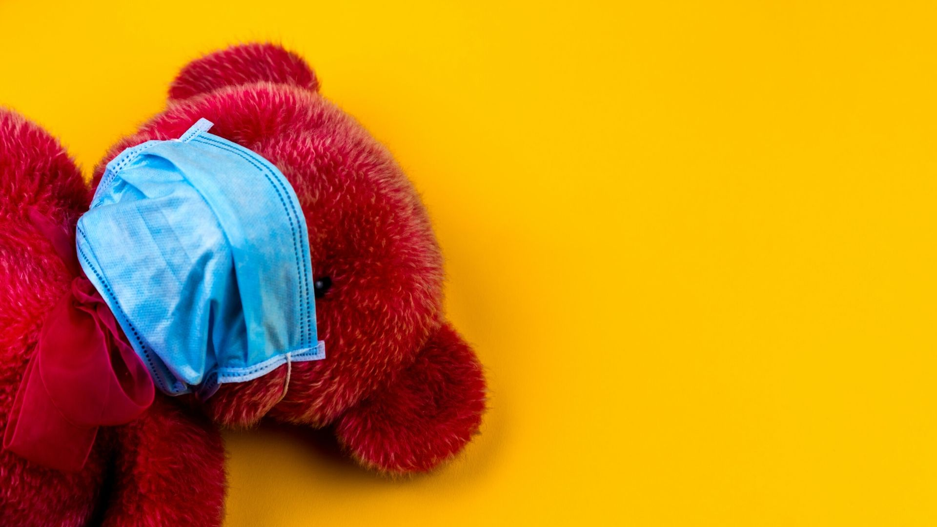Red Teddy in a surgical mask on a yellow background - helping anxious children to trust God