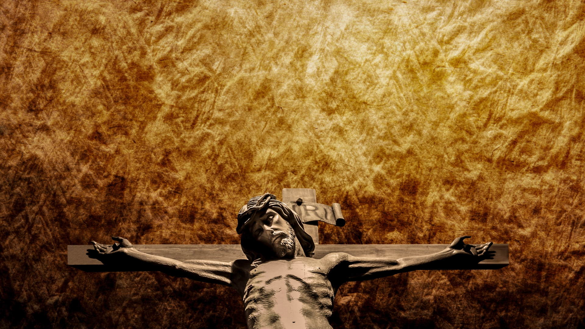 The Death of Christ: Jesus on the Cross - Background of heat shimmer in orange and brown