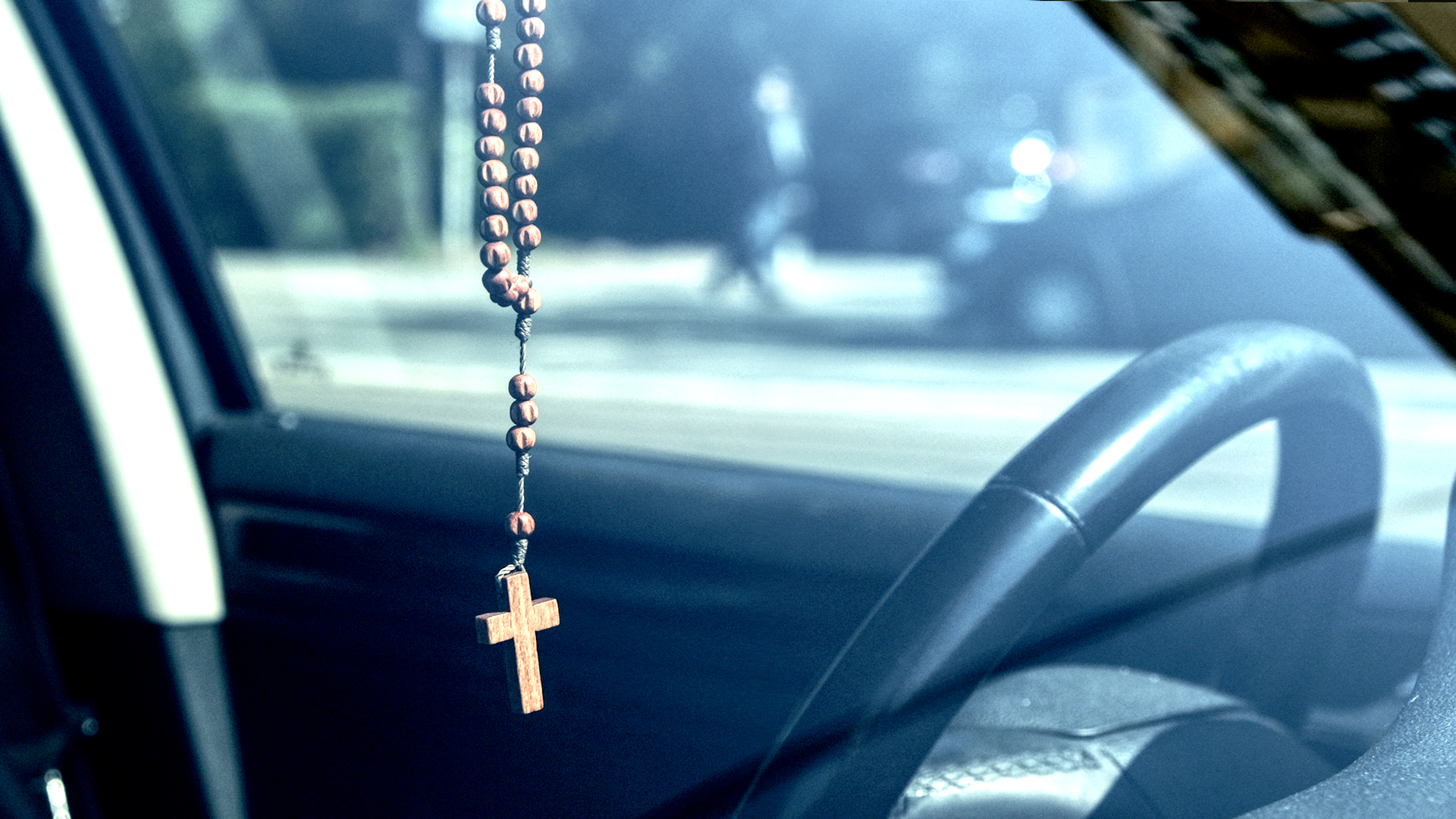 Fetishes are objects used to protect us - like this cross hanging from the rear-view mirror of a car