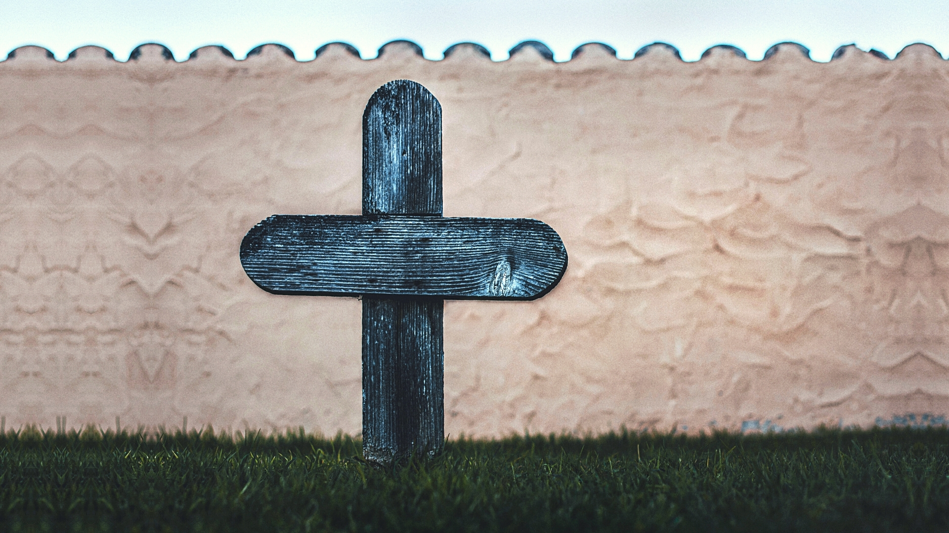 A lone wooden cross in a graveyard - are those who commit suicide eternally damned?