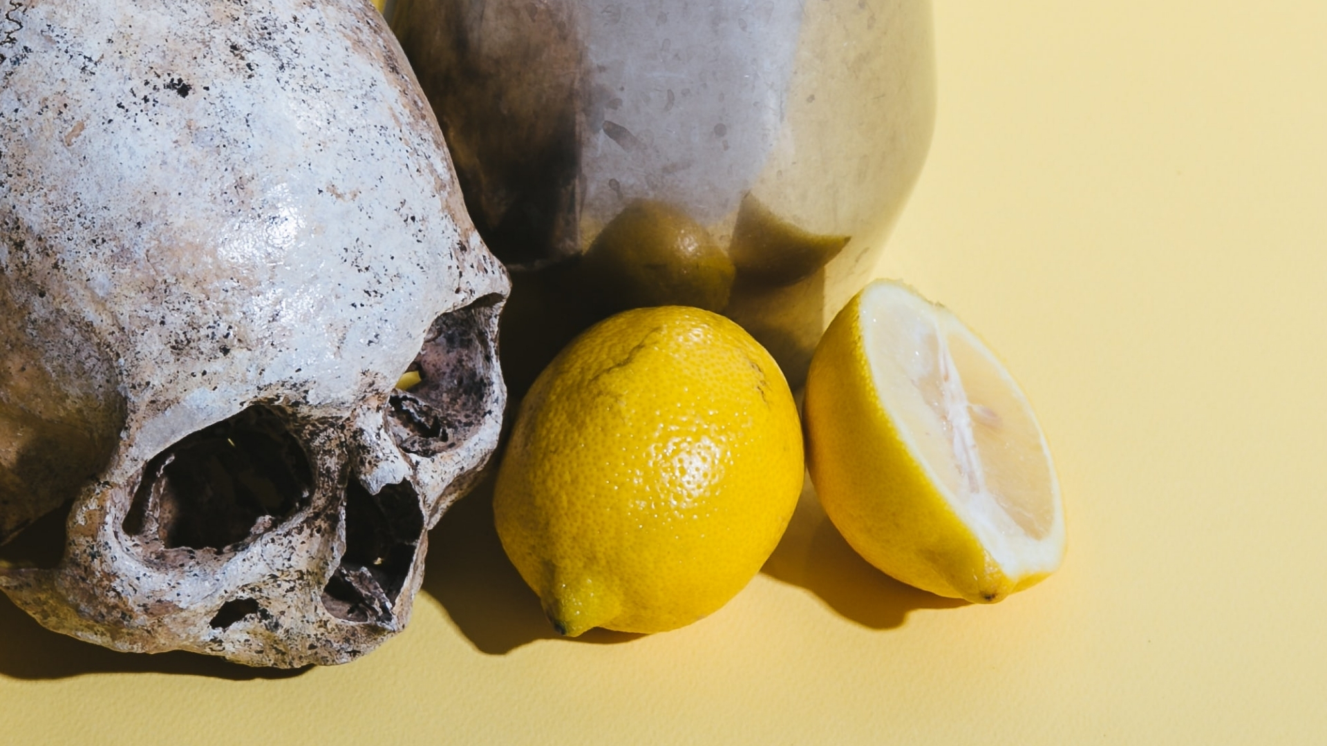 What Makes Christian Cults dangerous? Fresh lemons with a silver jug and a skull - death and sour fruit