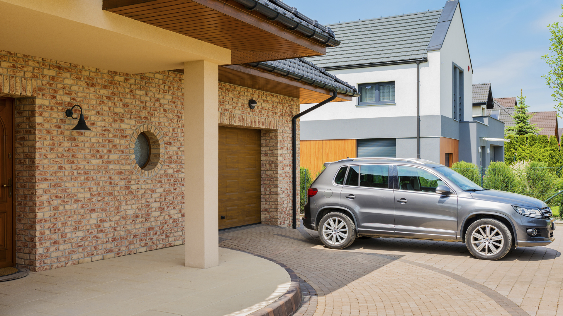 Is this success? What does God want for my life? Image of townhouse and car in an estate