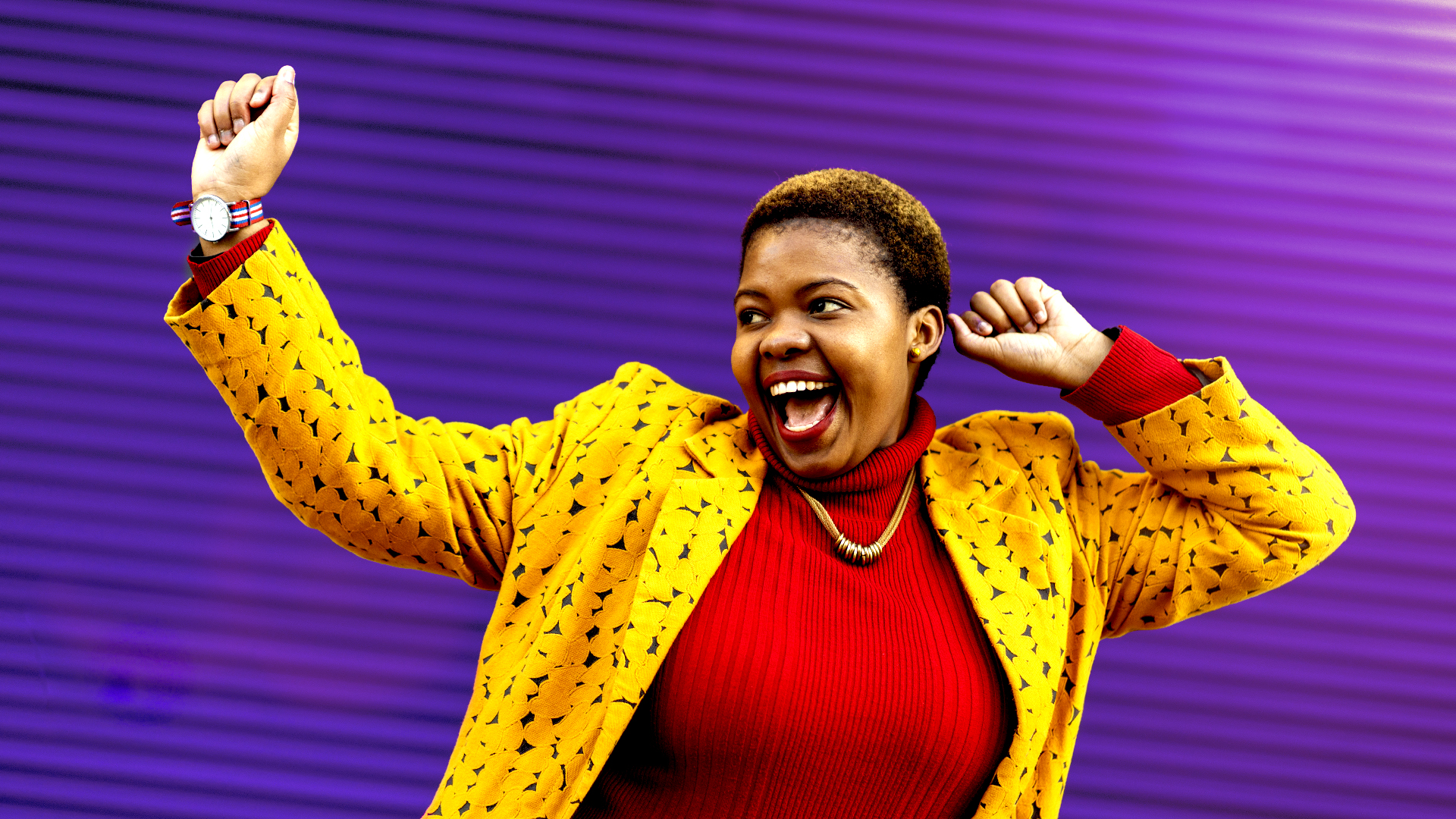 Wrestling with Biblical Womanhood - African woman partying on a bright purple background