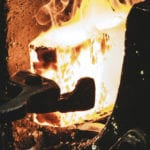 A block of white hot metal being shaped in a furnace - a crisis will shape your faith