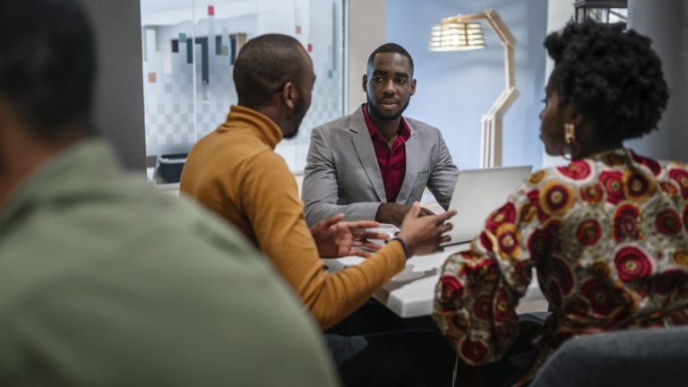 A group of African Entrepreneurs around a table having a meeting