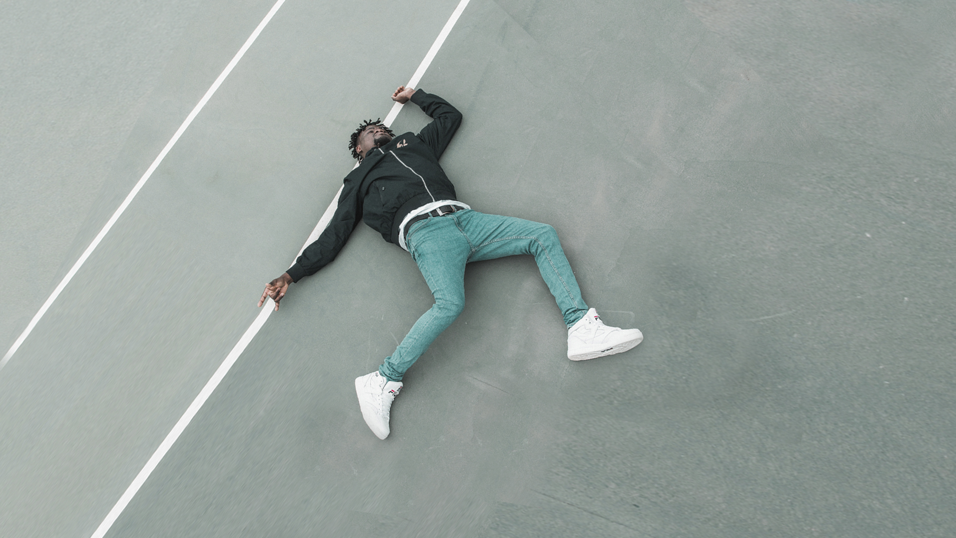 Floored by personal sin - young African man lying on tarmac
