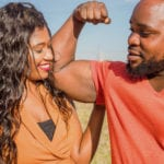 Zambian Couple - Man flexing his bicep as woman hugs him. Are Faithful husbands weak?