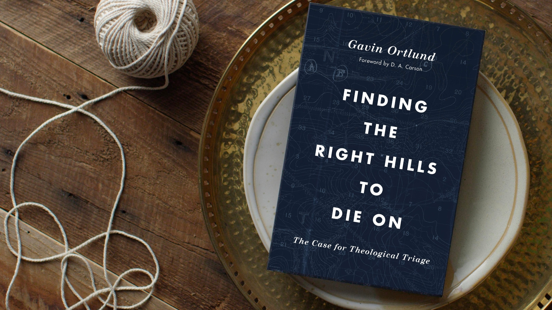 How to pick the right theological fights - Finding the right hills to die on - book on table top