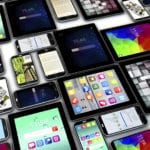 Technology - a patchwork flat-lay of devices with screens on