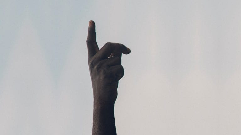 Rightly claiming the promises of Psalm 91 - African hand pointing to the sky