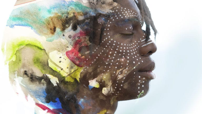 Living out a christian identity - African man with beautiful colours in his brain translating to a peaceful, traditionally painted, face