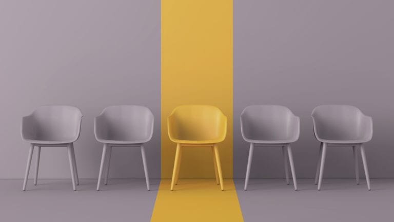 Christianity and the pursuit of tolerance - only one yellow chair in a row of grey ones