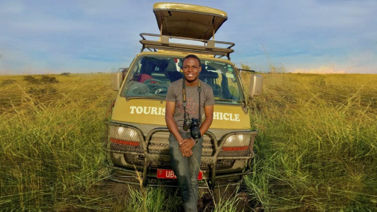 Expository preaching is like being a local in a tourist attraction - Ugandan tourist guide leaning on his vehicle in the veld