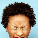 The Cure for Spiritual Blindness - African woman with her eyes tightly closed