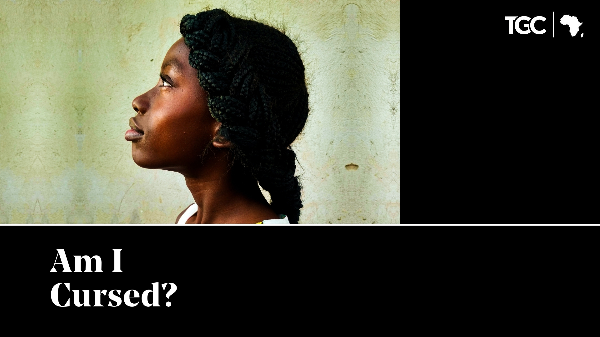Am I Cursed - Zambian woman looking up with plain wall background