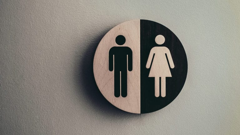 Sex and Creation: We are made in the image of god. Image of male and female sign in a circle