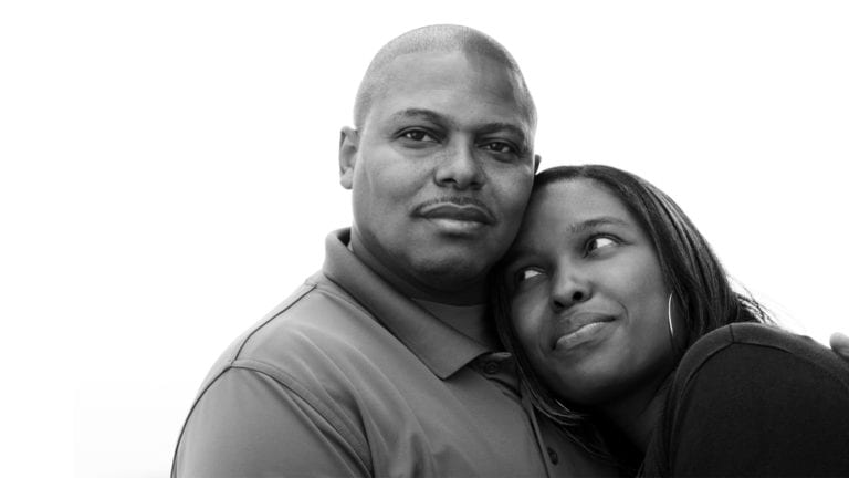 Gender roles in marriage - Aouth African couple embracing looking calm and happy