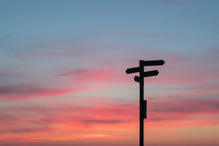 How to take big decisions wisely - signpost on a sunset sky