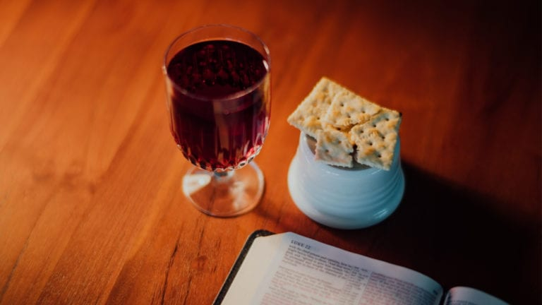 Christianity, religion or a way of life? holy communion and an open Bible on a table