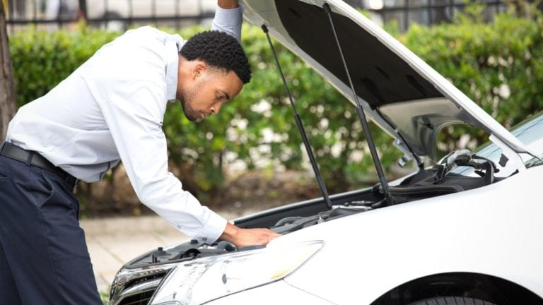 African man looking at the engine of his car, we also need to examine the engine of the church