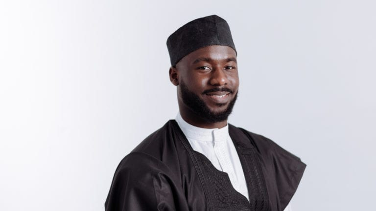 Should a Christian go into politics? Nigerian politician smiling in black and white outfit
