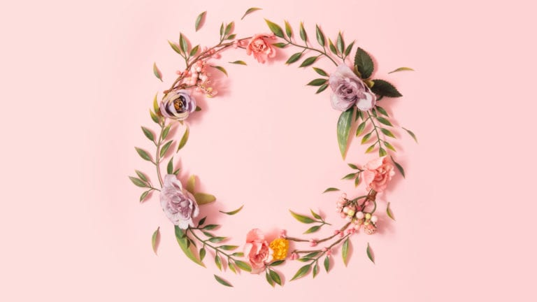 Female Genital Cutting & The Role of The Church - A circlet of delicate flowers on a pink background