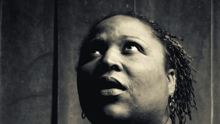 Generational curses - the dangers: African woman looking up and back, full of fear