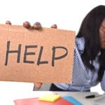 Help! Is paying black tax biblical? African woman professional with head in hands